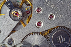 Metallic Gears Inside of a Luxury Watch